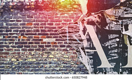 Urban Concrete Brick Wall With Copy Space. Grunge old wall with torn posters as creative and abstract background.
