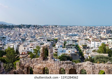 Urban contrast - ancient monuments and modern constructions of Athens, Greece