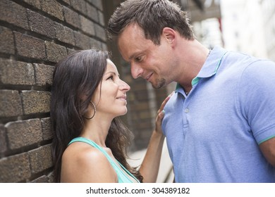 A urban couple on a street having fun