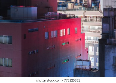 Urban creepy building and red reflection.