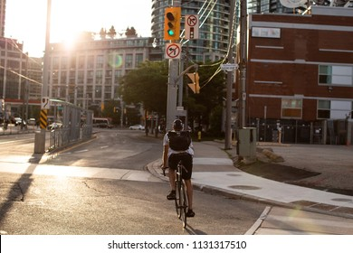 Urban cyclist with sunset
