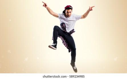 Urban dancer on ocher background