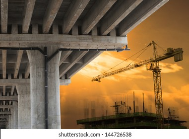 urban development by big crane building construction  with beautiful sky in evening scene