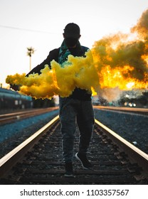 Urban exploration Los Angeles 2018. Masked man with smoke. Unidentifiable