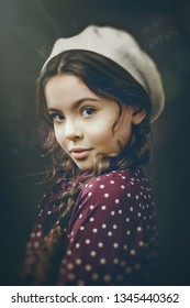 Urban female portrait. Beauty young girl turned around and looking at camera