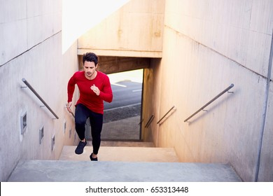 Urban fitness, young man running on stairs doing interval hiit cardio workout