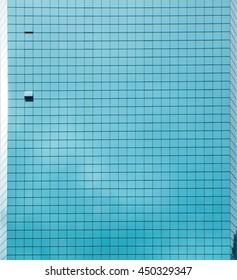Urban geometry blue glass building