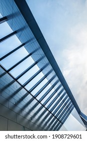 Urban Geometry, looking up to the building. Modern architecture, concrete, and glass. Abstract architectural design. Artistic minimalism image. Modern architecture concept image.