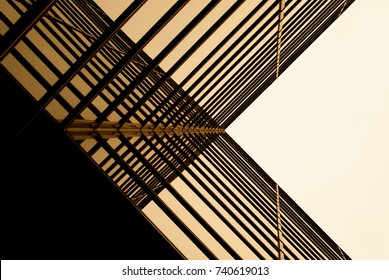 Urban Geometry, looking up to glass building. Modern architecture black and white, glass and steel. X marks the spot. Abstract architectural design. Inspirational, artistic image