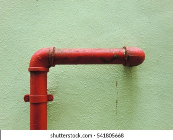 Urban ghetto pipe plumbing against grungy wall texture