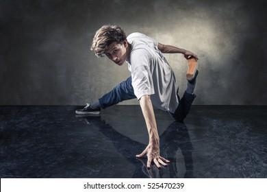 urban hip hop dancer over grunge concrete wall