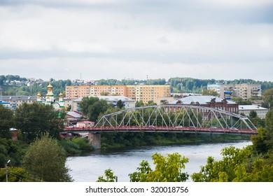 urban landscape with a bridge across a calm river
