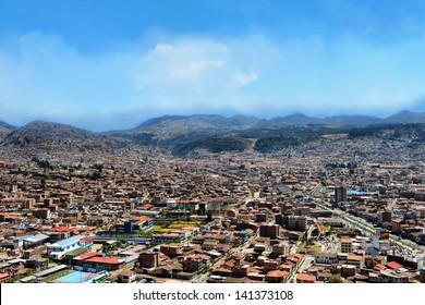 Urban landscape of Cusco, Peru. A view from a mountain.