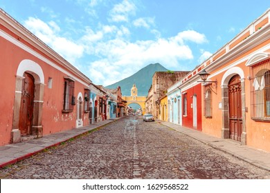 Urban landscape on the main street of the Antigua City with the Agua volcano in the background, Guatemala.