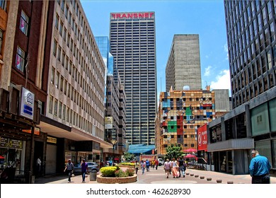 Urban landscape. People walk in the city. The modern view of Johannesburg. The biggest city of South Africa. CBD. Johannesburg, South Africa - December 21, 2013