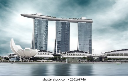 urban landscape of Singapore under a cloudy sky