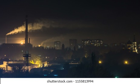 Urban landscape smoked polluted atmosphere from emissions of plants and factories, view of pipes with smoke and residential apartment buildings timelapse.