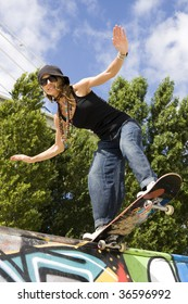 Urban life - Beautiful young women with skateboard