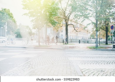 Urban life scene with anonymous crowd of people walking on a busy French street