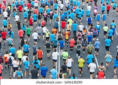 Urban marathon runners on the street. Healthy lifestyle. Athletes endurance