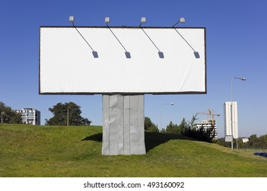 The urban metal mass production empty  billboard for outdoor advertizing. On a framework will pull a pure white canvas. Sunny autumn day landscape.