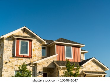 Urban modern facade houses and homes in modern suburb the best place to live in Austin Texas a modern suburbia neighborhood stone and brick luxurious living spaces with blue sky