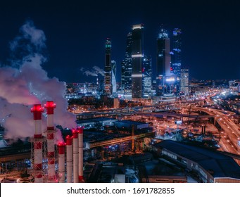 Urban Moscow view, Moscow City Towers through industrial pipes, aerial view