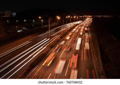 Urban Night Scape.(Night image) The cars are running on the night road.