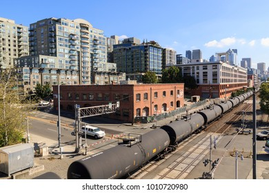 Urban office block, railroad and Alaskan Way with Downtown visible in background,  District, Seattle, Washington, USA North America 20 September 2017