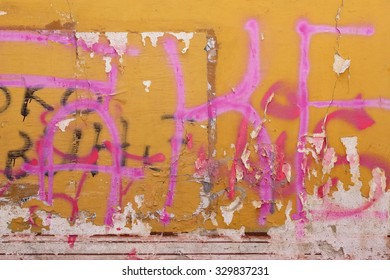 Urban Old Concrete Graffiti Wall With Peeled Paint And Ripped Ads Background Texture