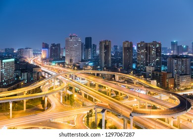 urban overpass at night, modern city skyline and traffic background