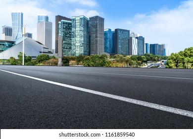 Urban road asphalt pavement and skyline of Hangzhou