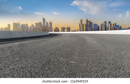 Urban road asphalt pavement and skyline of Hangzhou architectura