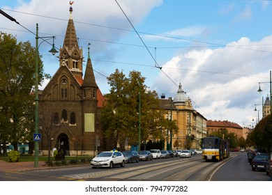 Urban scape with Reformed Church in hungarian city Szeged in autumn day