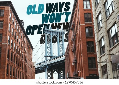 """urban scene with buildings, brooklyn bridge and """"old ways wont open new doors"""" lettering in new york city, usa"""