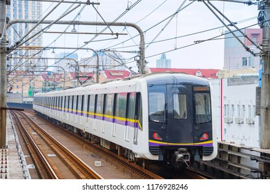 Urban scene with subway train arriving to the station, Shanghai