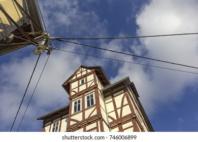 Urban Scene in Treffurt, Thuringia. Timbered House with an old and lamp and electric wire.
