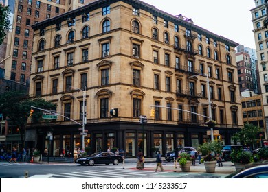 Urban setting of downtown with traffic on roads and high vintage building with apartment and flats for rent,cityscape with exterior of residential real estate located near crossroads in megalopolis