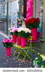 Urban setting flower shop with flower display on the sidewalk.