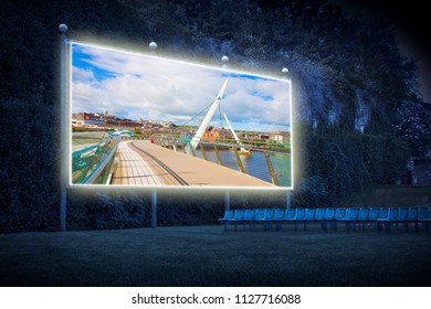 """Urban skyline of Derry city (also called Londonderry) in northern Ireland with the famous """"Peace Bridge"""" (Europe - Northern Ireland) - Outdoor cinema concept image"""