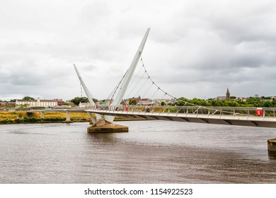 """Urban skyline of Derry city (also called Londonderry) in northern Ireland with the famous """"Peace Bridge"""", Europe - Northern Ireland"""