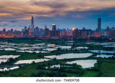 Urban skyline and modern buildings of China, cityscape of China at sunset, View from hiong kong countryside. Shenzhen is a major city in Guangdong Province, China.