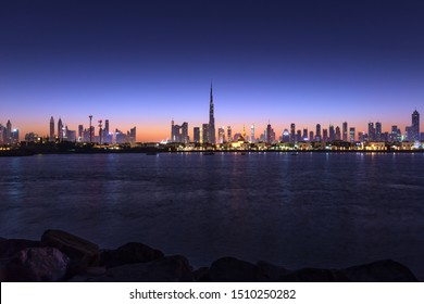 Urban Skyline and modern skyscrapers in Dubai UAE at sunrise.