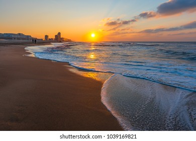 The urban skyline and North Sea beach of Ostend City at sunset along the Belgian coast, West Flanders, Belgium, Europe.