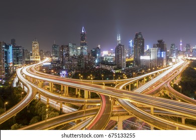 urban skyline and overpass at night in Shanghai