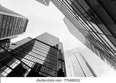 Urban skyline with skyscrapers. High-rise office buildings in city of Hong Kong. Black and white photo