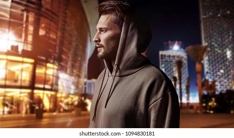 urban sports concept, young healthy man jogging in the city on the evening