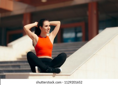 Urban Sports Girl Resting After Outdoors Training Session. Portrait of an athletic woman having a rest in between exercise sessions