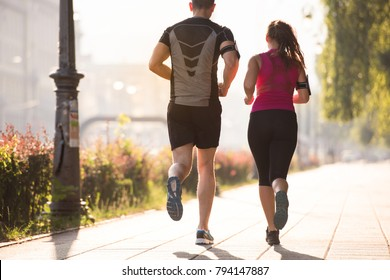 urban sports, healthy young couple jogging  in the city at sunny morning