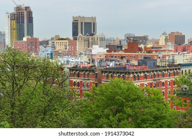Urban spring landscape of South Harlem and Morningside Park from Morningside Drive in Morningside Heights. New York City
